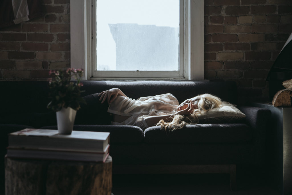 Woman lying on the couch. Photo by Benjamin Combs