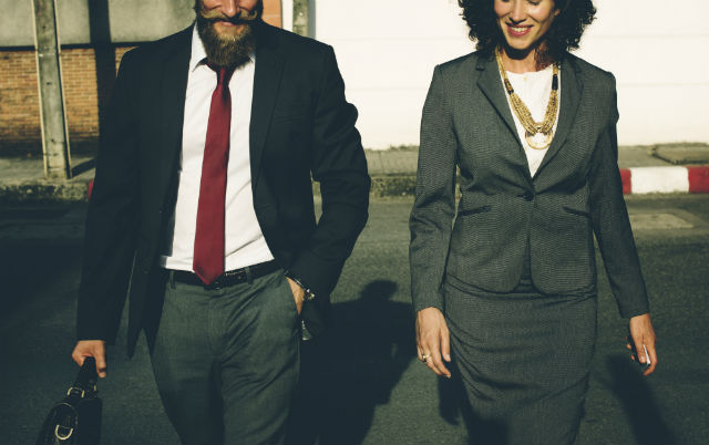Business professionals walking together